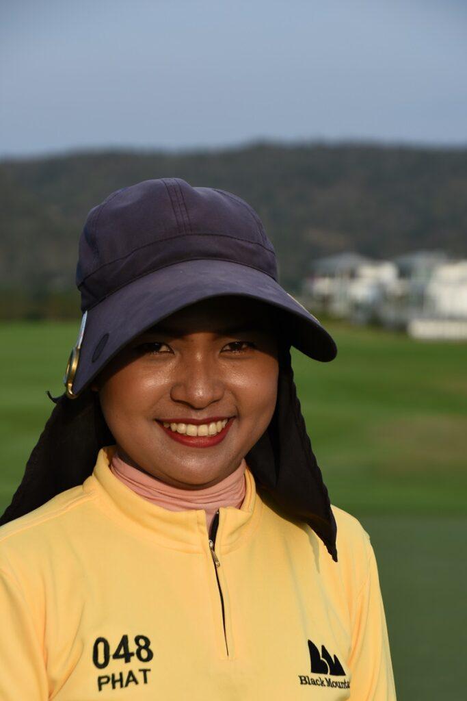 golfbana och caddy i Thailand
