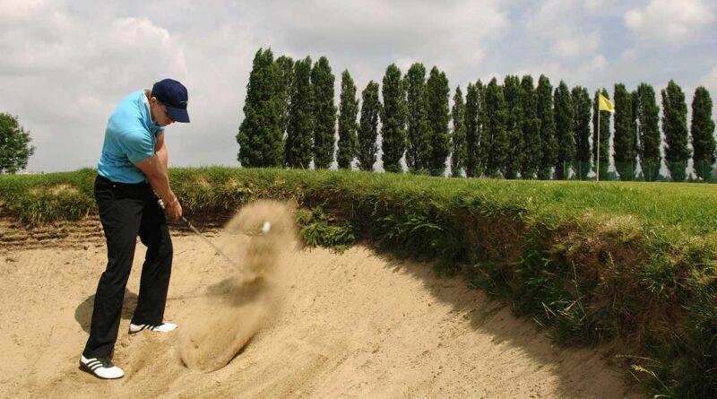 Golfspelare i bunker